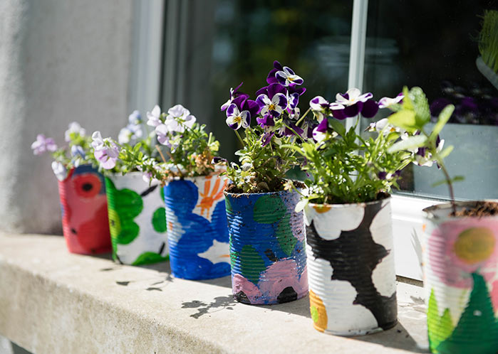 Painted cans with flowers